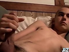 Shaved head skinny boy strokes his obese cock