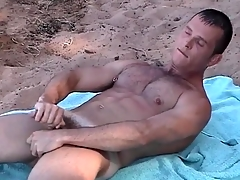 Pierced nipple gay guy jerks off on a difficulty beach