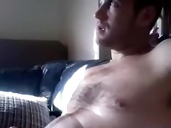 Dishy guy is having fun at home and filming himself upstairs computer webcam