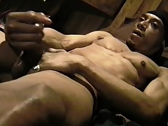 Muscled black stud massages his big balls and strokes his bulky prick